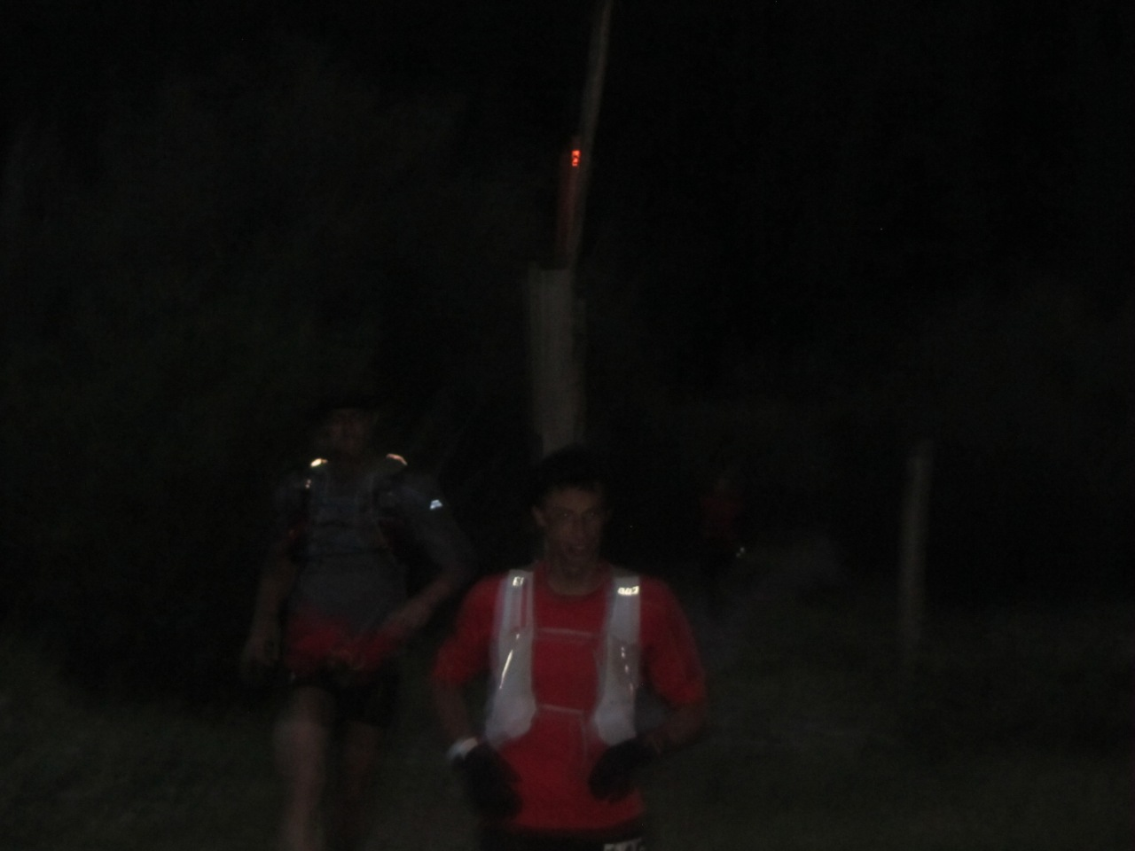 Kilan Jornet and pacer Rickey Gates comming into Burrows park aid station